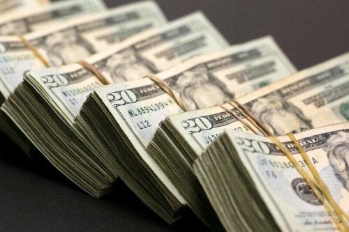 Dollar w górę, ale blisko miesięcznego niskiego poziomu nakarzywania opóźnienia opóźnienia przez Investing.com